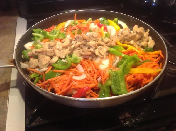 Return steaks to skillet, then add  in all of the chopped veggies and...