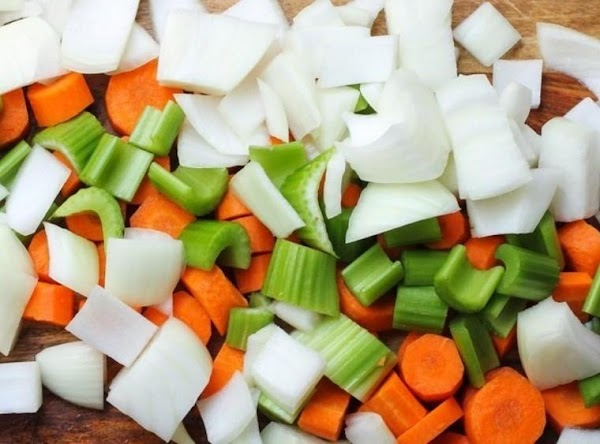 In a large stockpot, heat olive oil over medium heat. Stir in onion, celery,...