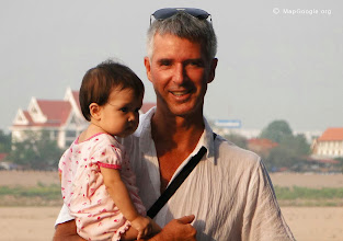 """Photo: Perth based publisher with daughter at home town of """"Si ChiangMai"""" 400 metres south of Vientiane, Laos."""