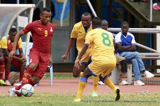 Photo: Jacques Tuyisenge (9) & Haruna Niyonzima (8) close in on Jordan Ayew (9) [Rwanda Vs Ghana AFCON2017 Qualifier, 5 Sep 2015 in Kigali, Rwanda.  Photo © Darren McKinstry 2015