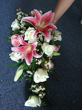 Photo: [B15] Cascade bouquet of pink stargazer lilies, white and pink roses, and accented with white waxflower