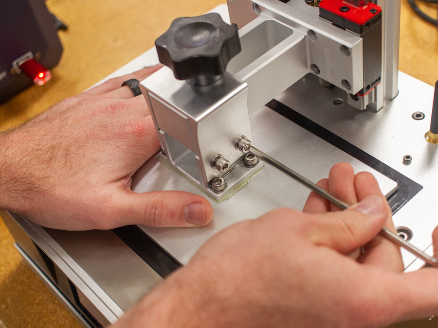 Before you jump right into 3D SLA printing, make sure you level your build plate with its newly installed surface and tighten those leveling screws.