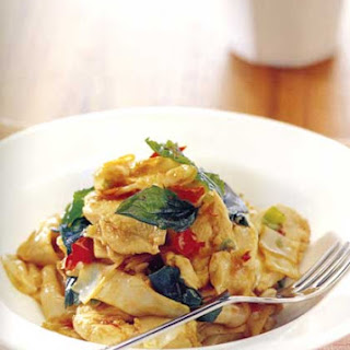 Rice Noodles Stir-Fried with Chicken, Fresh Chili, Garlic and Basil.