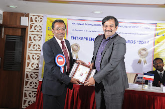 Photo: Prof. Dr. R. Ganesan, Chairman  NFED Issuing the Best Entrepreneur Award to   Dr. S. Ravichandran, CEO & Chief Scientist, Knowledge Partners Technologies Pvt. Ltd., Chennai