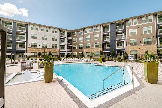 Apartment building surrounding luxury swimming pool