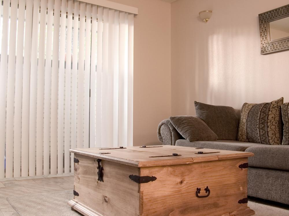A cozy living or family room with vertical blinds.