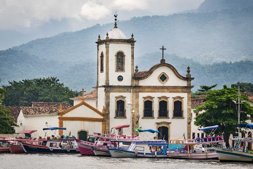 Visit Paraty, a small town backed by mountains on Brazil's Costa Verde, on a Ponant cruise.