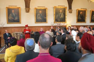 Photo: Community reps listen attentively to the Queen.