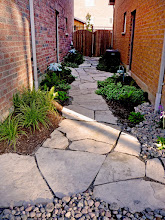 Photo: How to handle that dark area between two homes? This flag path with garden pockets of shade tolerant plants and copper lighting is the perfect way.