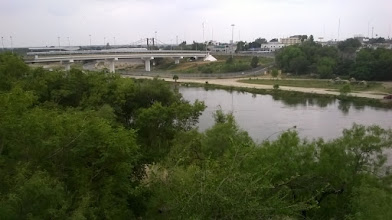Photo: Roma bluffs with old bridge