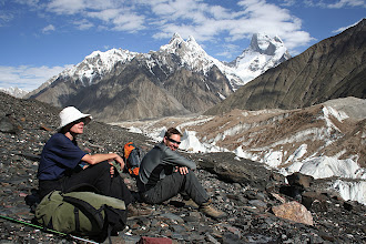 Photo: Anette and Huge relaxing on the Baltoro Glacier. The Mustagh Tower (7284m) is beyond with its summit in cloud.