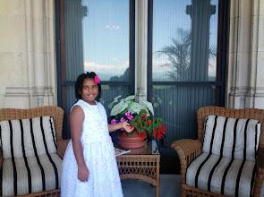 Photo: Kaleya loves her flowers!