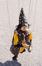 """Photo: Randy and Sheryl gave me this puppet to improve. Originally the hands were glued to the ends of the orange sleeves. I made jointed arms and black sleeves. I attached strings to the sides and back of the head and the lower back. This puppet is not for """"The Trouble With Death Traps."""""""