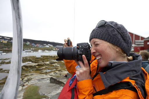 A photographer on Hurtigruten's expedition ship Fram in Greenland.