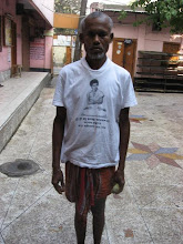 Photo: The sweeper and maintenance worker at the ashram