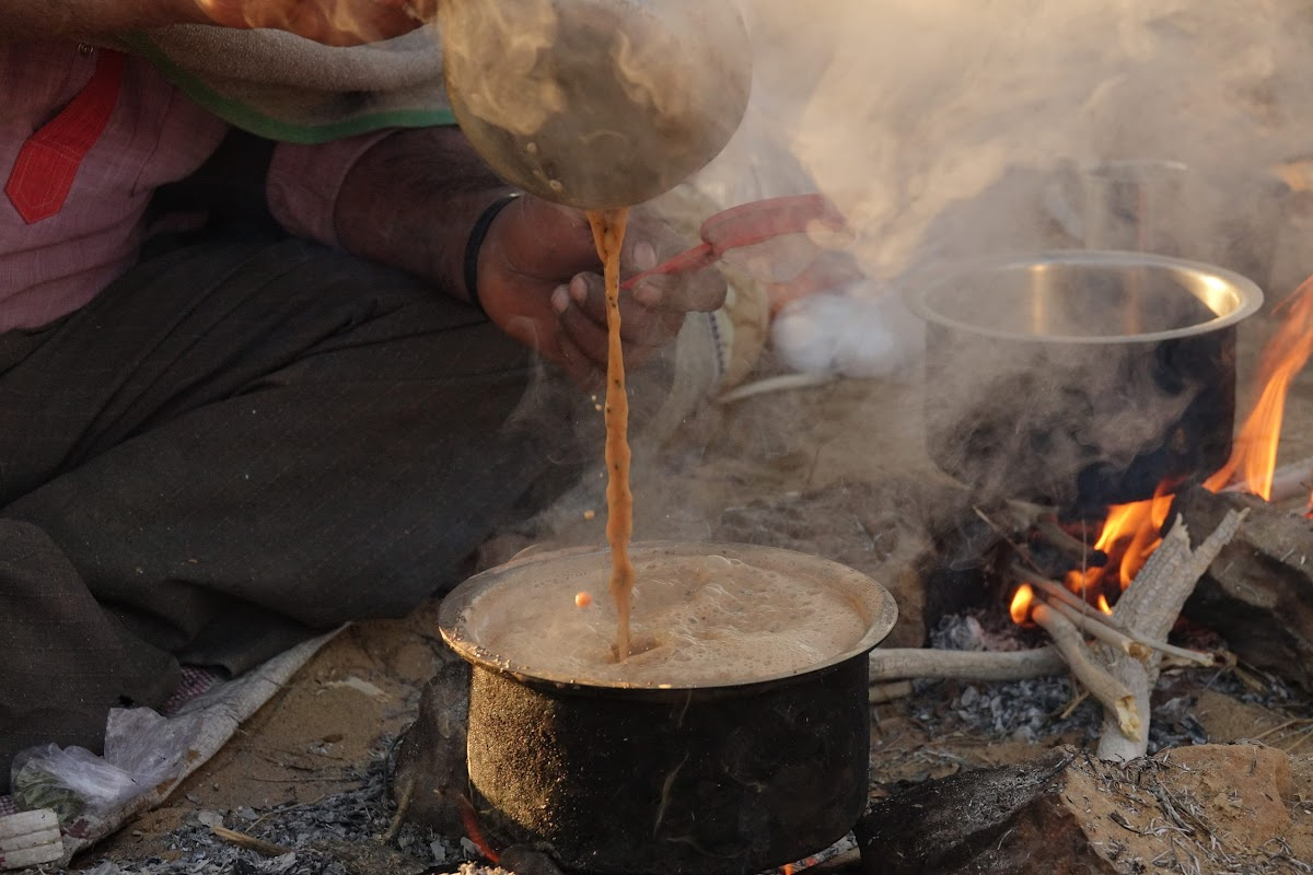 India. Rajasthan Thar Desert Camel Trek. The art of preparing chai
