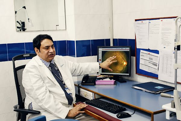 Dr. Rajiv Raman reviews a patient's retina image for signs of diabetic retinopathy.