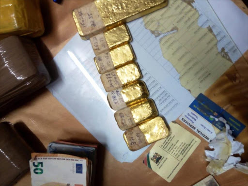 Seven metal bars suspected to be gold seized by the DCI./ COURTESY