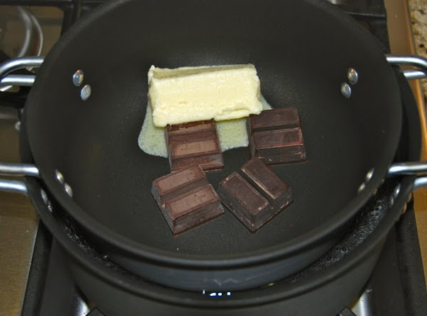 In a double boiler over simmering water, melt the butter and chocolate. Remove the...
