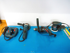 Photo: from left to right: a jig saw, an angle grinder, a drill, and a random orbital sander