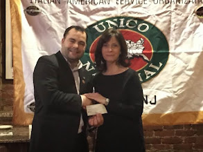 Photo: Chapter President Anthony Nigro presents a donation to the Verona Public Library's Italian and Italian American book collection. Accepting on behalf of the Library is Chapter Member Nancy Magrans.