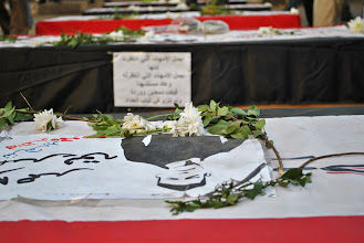 Photo: A row of symbolic caskets commemorating those killed during the battle of Mohamad Mahmoud St.