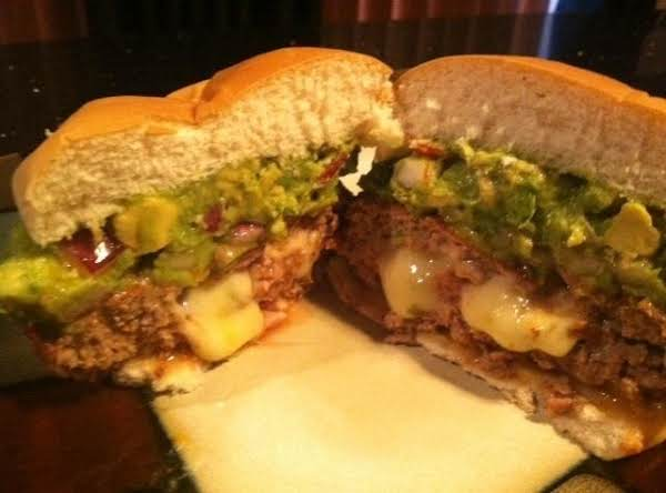 Monterey Jack Stuffed Mexican Hamburgers With Guacamole Topping Recipe