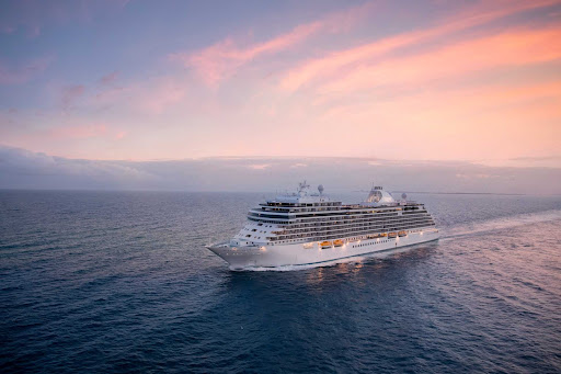 An aerial view of the ultra-luxury ship Seven Seas Splendor at sunset.