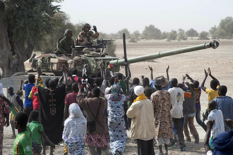 Photo: In this Monday, Jan. 28, 2013, photo provided by the French Army Communications Audiovisual office (ECPAD) and released Tuesday, Jan. 29, 2013, a crowd cheers the arrival of French soldiers in Timbuktu, in northern Mali. Backed by French helicopters and paratroopers, Malian soldiers entered the fabled city of Timbuktu on Monday after al-Qaida-linked militants who ruled the outpost by fear for nearly 10 months fled into the desert, setting fire to a library that held thousands of manuscripts dating to the Middle Ages. (AP Photo/French Army Communications Audiovisual office (ECPAD), Arnaud Roine)