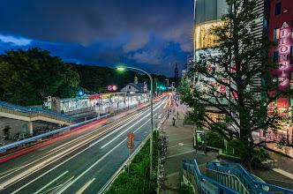 Photo: Cars pass by Harajuku Station in Tokyo, Japan