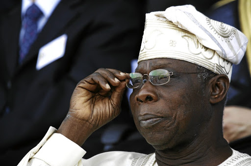 Time for action: Former Nigerian president Olusegun Obasanjo watches an inauguration ceremony in Senegal in this file picture. He says SA and Nigeria need to get their houses in order, politically and economically. Picture: REUTERS