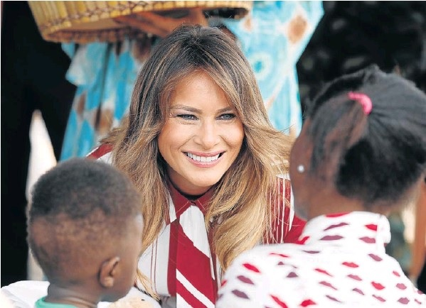 US first lady Melania Trump greets children during a visit to a hospital in Accra, Ghana, on Tuesday