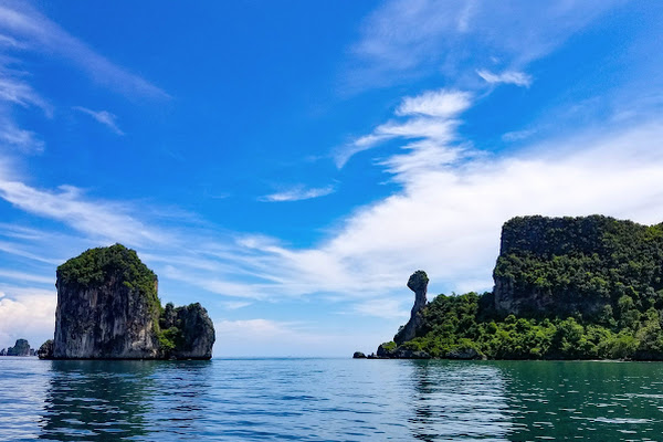 The guide will point out how Koh Kai island looks like the head of a chicken