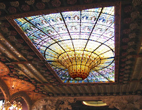 Photo: Barcelona's ornate Palau de la Música Catalana does not require additional, artificial lighting during daylight hours. Sunlight pours through the colorful skylight (which weighs about a metric ton and is built directly over the stage to properly illuminate daytime concerts.) Stained-glass windows also surround the 2,200-seat hall, further eliminating the need for electric lighting (although lighting is available for night time concerts). Completed in 1908 by Domènech i Montaner, the Modernist hall was constructed to resemble a Gothic cathedral to lend a sacred touch to the space, which is used mainly to stage concerts of choral music.