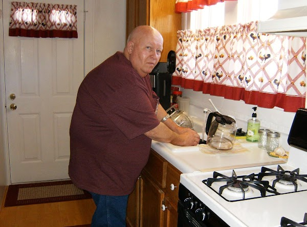 This is a picture of my Hubby, Fred. He's helping me out, doing the dishes. Gotta love them for that.