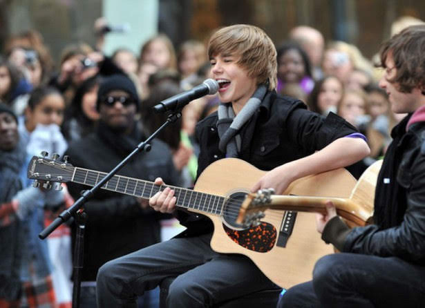 Justin Beiber Playing a guitar