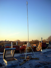 Photo: 20foot mast with Ubiquiti Nanostation M5 at the top