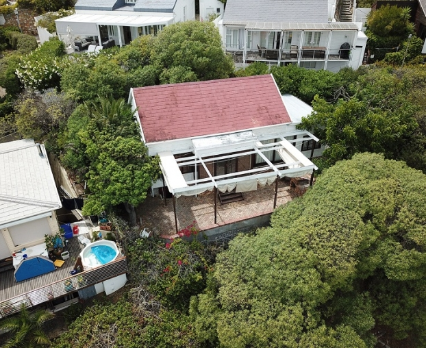 One of the original bungalows on Clifton's Fourth Beach is going up for sale.