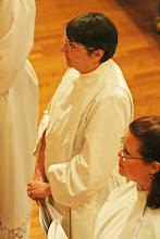 Photo: Suzanne LeVesconte listens to the bishop's challenge