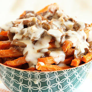 Duck Confit Sweet Potato Fries with Smoked Gouda Cheese Sauce.