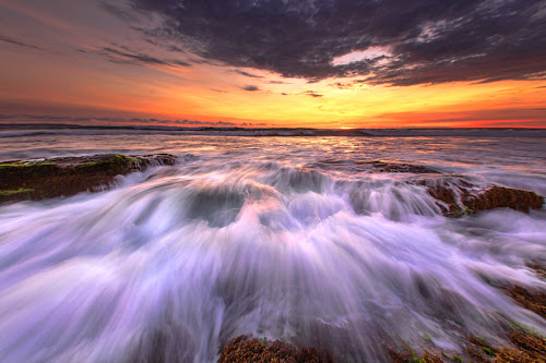 Attacking Me  by Bertoni Siswanto - Landscapes Sunsets & Sunrises ( travel photography, waves, cloud, bali, seascapes, waterscapes, golden hour, beach, sunsets, indonesia, landscape, sundown,  )