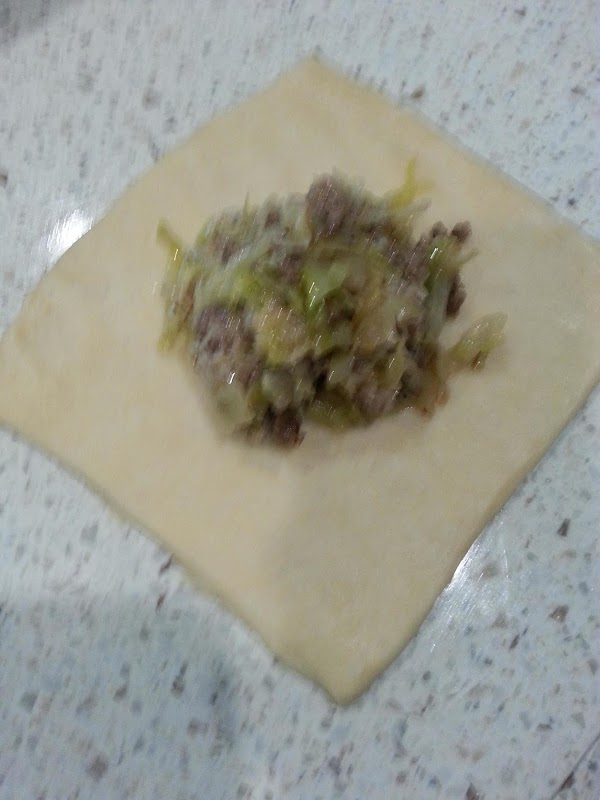 put 1/3 C of filling in a square of dough