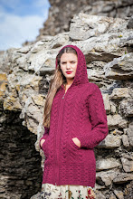 Photo: Hooded Coatigan with Celtic Knot Zipper Pull -  This Hooded Coatigan features the popular Cable pattern in a downwards direction resulting in a flattering and slimming effect. The Coatigan's long style and slim fit, adds to its attractive appeal as a garment. Key features include a delicate Celtic Knot design on the zipper and a beautiful hood which also provides an extra element of practicality to the wearer.  www.aransweatermarket.com/hooded-coat-with-celtic-knot-zipper-pull
