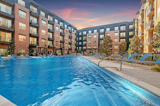 Los Altos Trinity Green's resort-style swimming pool at dusk