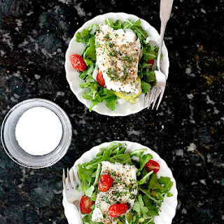 Foil Baked Cod Fish With Grape Tomatoes.