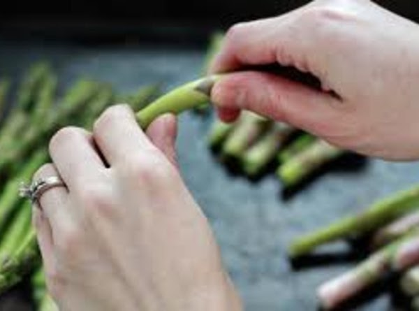Break the woody tips off the asparagus, and thinly slice it, including tips, crosswise...