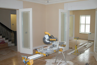 Photo: July 2006 - Month 35: Rooms begin to look finished. Floors sanded, doors and crown molding installed, door trims going up.