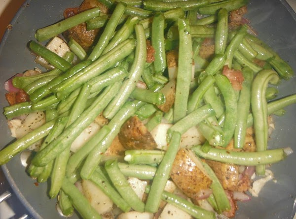 Sauté onions and pepper flakes in bacon grease, add green beans, potatoes and chicken...