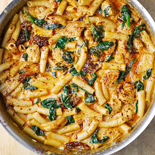 Asiago Chicken Pasta with Sun-Dried Tomatoes and Spinach.