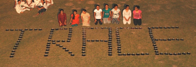 Photo: Formation of word 'TRACE' with plates by Samved girls